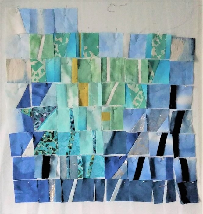 small quilt blocks pinned to design wall in Doris Lovadina-Lee's studio
