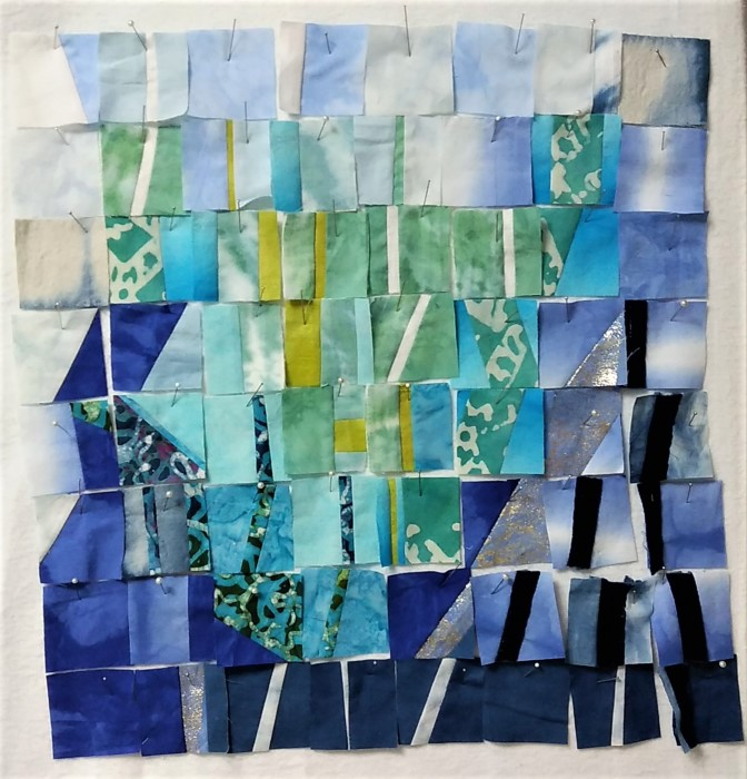 quilt blocks pinned to design board for SAQA theme spring by doris lovadina-lee in progress