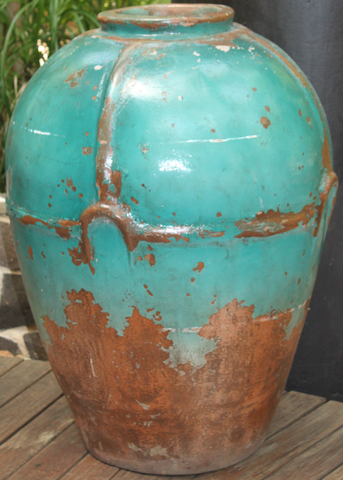 turquoise glaze on a ceramic jar in lobby of hotel in the Mayan Riviera