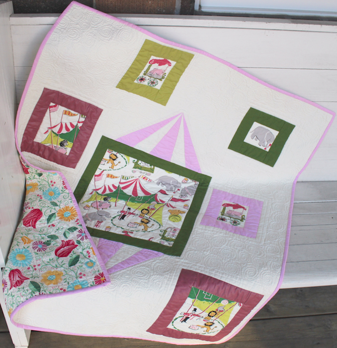 free motion quilting in modern circus baby quilt by Doris Lovadina-Lee
