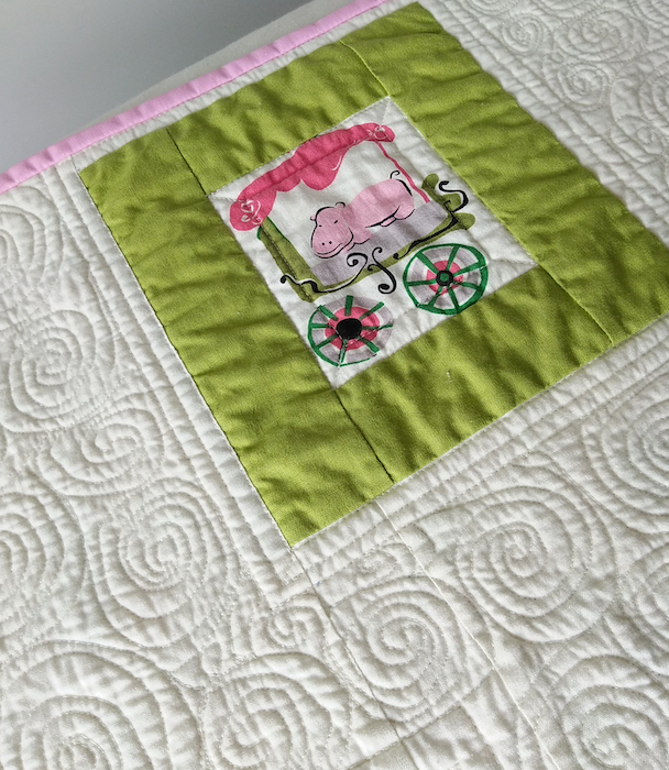 Pink hippo in modern circus baby quilt by Doris Lovadina-Lee