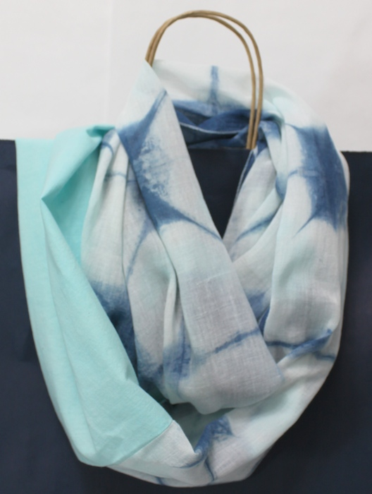 turquoise cotton gauze overdyed with indigo stitched with solid turquoise cotton to create an infinity scarf hand made by doris lovadina lee
