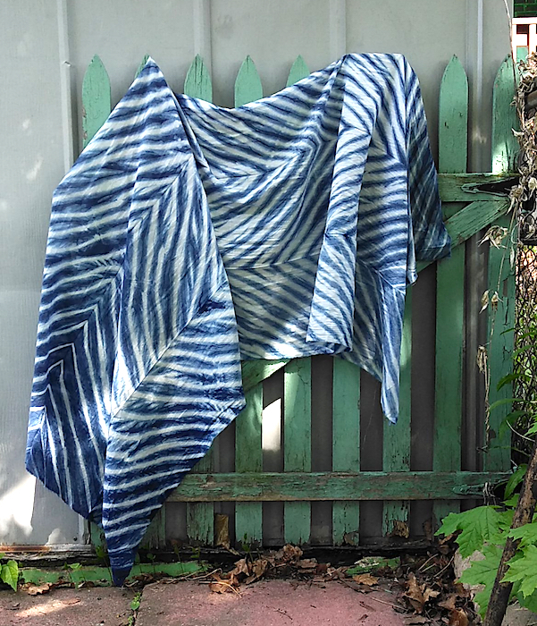 arashi shibori cotton rayon scarf draped on green fence by doris lovadina-lee