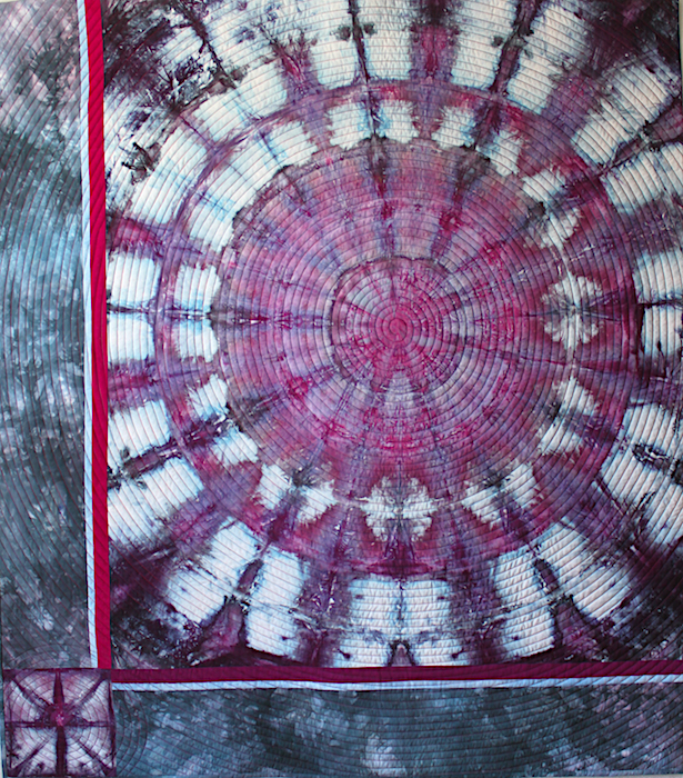 Cosmos quilt made by doris lovadina-lee using snow dyed mandala quilting cotton