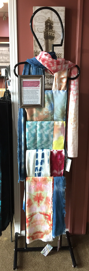 Hand dyed shibori and indigo scarves on display in Boutique Firenze London Ontario, scarves by Doris Lovadina-Lee