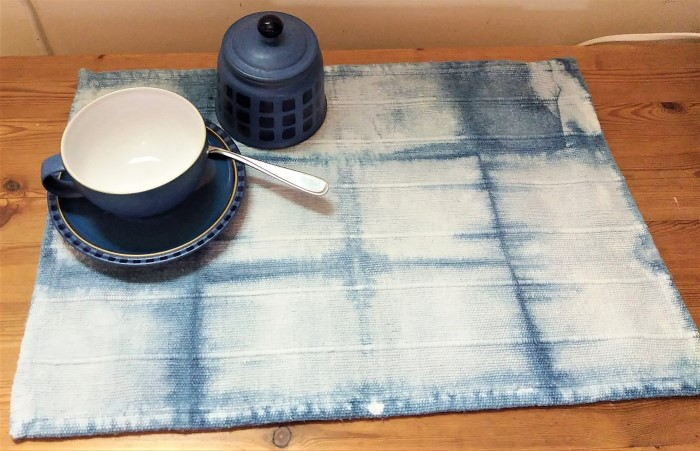 cup and sugar bowl on indigo dyed cotton placemat by doris lovadina-lee toronto canada