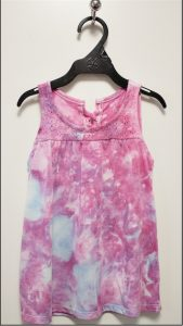 ice dyed shibori cotton top on hanger by doris lovadina-lee