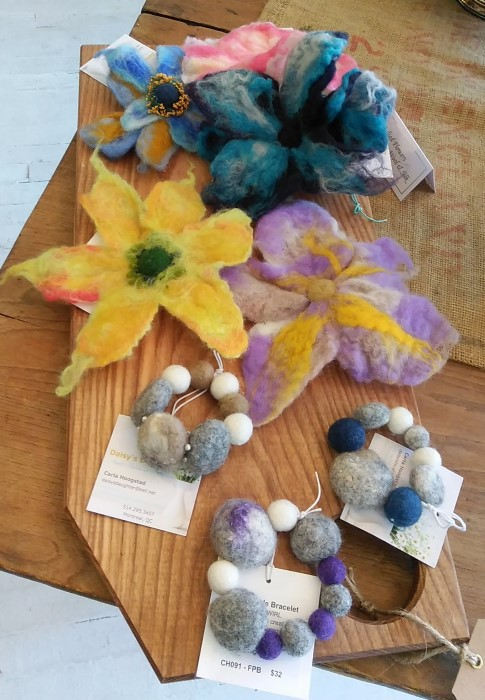 felted flowers and jewellery on wooden board at Field & Flower shop toronto ontario canada