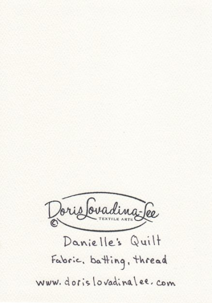 back of blank greeting card with doris lovadina-lee logo and title Danielle's quilt