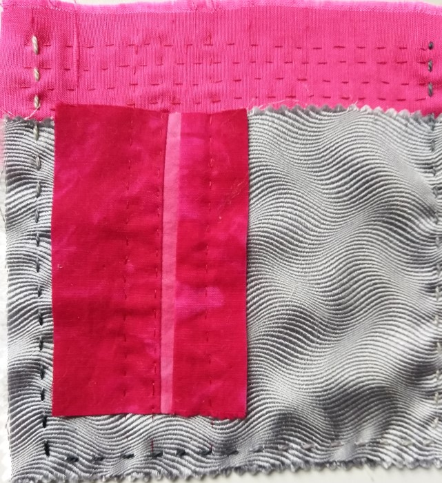 5 inch stitch meditation with grey silk, pink handdyed cotton with perle cotton and rayon thread