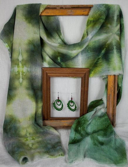 snow dyed linen crinkle scarf in shades of green with a small circle nestled in a larger circle hand crocheted in emerald green with beads by @maria.n.designs