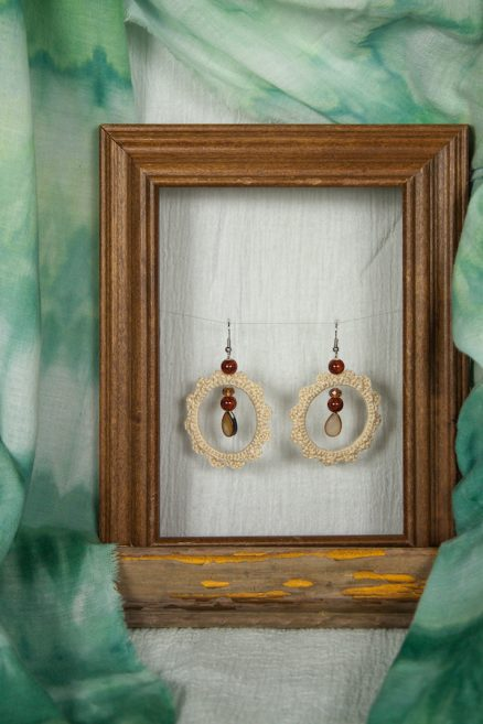 small wooden frame with green shibori scarf by doris lovadina-lee and hand crochet cream earings with tear drop bead