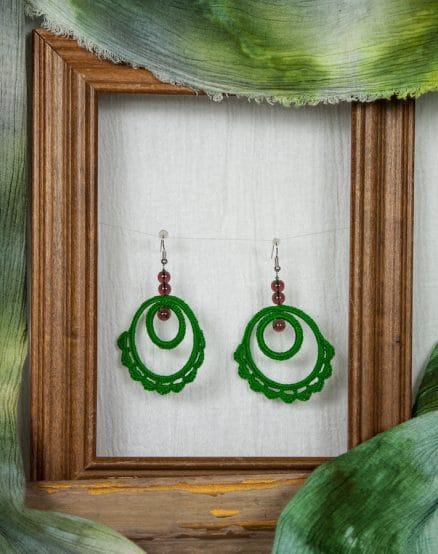 2 different sized hoops crocheted together to make unique earrings by maria nunes