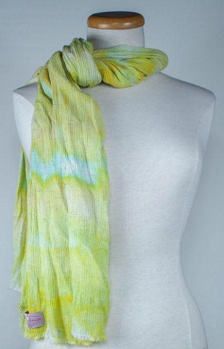 casually wrapped around the neck to display soft yellowy green and turquoise snow dyed in canada