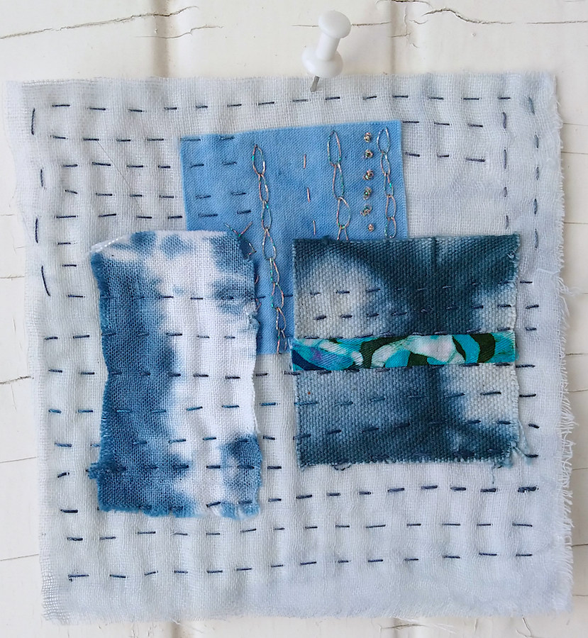 pale blue gauze stitched with patches of indigo dyed cloth by Canadian Textile artist Doris Lovadina-Lee