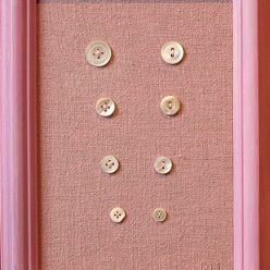 hand dyed cotton and 8 mother of pearl buttons in pink frame