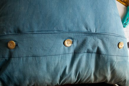 close-up of 3 button closure on pillow back
