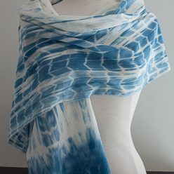 striped effect medium blue indigo scarf with border shibori dyed on a dressmaker's torso