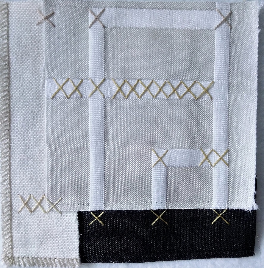 Repurposed upholstery fabric square and cross stitches