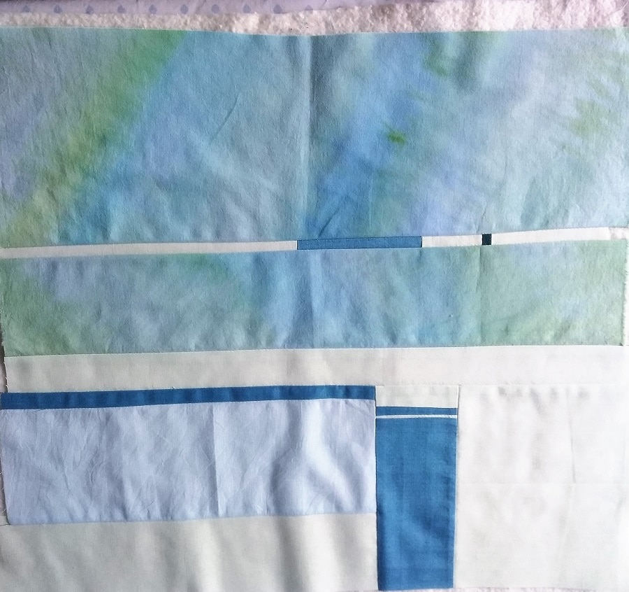 layers of fabric and quilt batting of a small quilt
