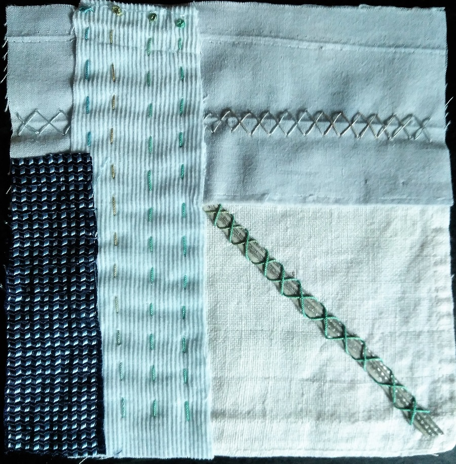 fabric and leather scraps stitched into a 5 inch square meditation